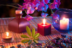 Leaf, candles, oil, potpourri,. Glass dots, orchids and bamboo - chromoterapy violet royalty free stock images