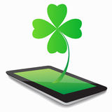 Leaf clover whit tablet computer Royalty Free Stock Photos