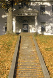 Leaf covered steps in fall in Windsor, VT Stock Image