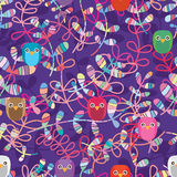 Leaf cut style owl handmade decor seamless pattern. This illustration is design style cut leaf and handmade owl decoration in purple color background and Royalty Free Stock Image