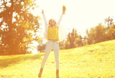 Leaf fall happy expression young woman having fun in warm sunny Stock Image