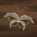 Leaf Glass butterfly with a yellow neon light over a wood background Royalty Free Stock Images