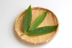 Leaf of Japanese wild ginger on the bamboo basket. It will be sold at a such as raw fish and crab on top of the leaves Stock Image