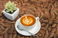 Leaf latte art in while cup Royalty Free Stock Photos