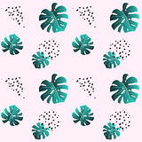 A leaf of monstera and dots. Pink seamless pattern. Pink seamless pattern a leaf of emerald monstera and black dots. Fashionable colors. Trendy texture for Stock Image