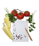 Leaf notebook in frame of vegetables Royalty Free Stock Images