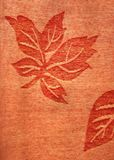 Leaf Pattern. Leaf motifs on a piece of fabric royalty free stock image