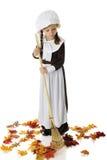 Leaf Raking Pilgrim Girl Royalty Free Stock Photo