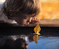 Leaf ship. In children hand Stock Photography