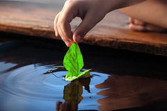 Leaf ship. In children hand Stock Images