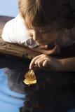 Leaf ship in children hand Stock Photos