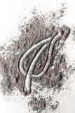 Leaf sign drawing in burnt ash, sand, dust, dirt Royalty Free Stock Image