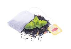 Leaf tea and a packet. Leaf tea and tea a packet on a white background Stock Photo