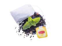 Leaf tea and a packet. Leaf tea and tea a packet on a white background Stock Photography