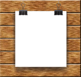 Leaf on wooden clothespin on the background. Clean square sheet for design Royalty Free Stock Photos