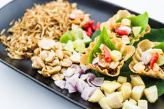 Leaf wrapped bite size appetizer. Royalty Free Stock Photos