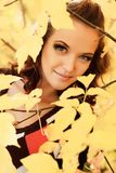 Among leafage. Young pretty woman at the autumn park Stock Image