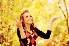 Leafage. Young pretty woman at the autumn park royalty free stock images