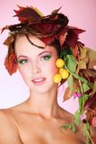 Leafage hairstyle. Portrait of a styled professional model. Theme: beauty, autumn fashion Stock Photos