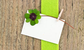 Leafed clover. And card on wooden board stock images