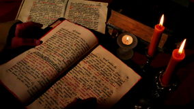 Leafing through Old Religious Book stock footage