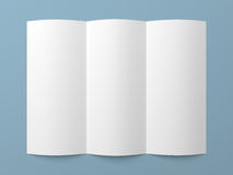 Leaflet blank tri-fold white paper brochure. Mockup on blue background Royalty Free Stock Photos