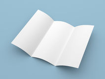 Leaflet blank trifold white paper brochure. Mockup on blue background Stock Photography