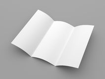 Leaflet blank trifold white paper brochure. Mockup on grey background Stock Photos