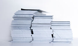 Leaflet stock. A pile of scrap advertising leaflet on white background Royalty Free Stock Photography