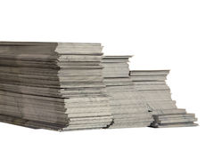Leaflet stock. A pile of scrap advertising leaflet on white background Stock Image