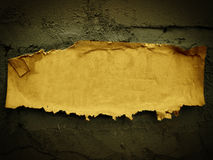 Leaflet on a wall. Yellow Leaflet on a grey wall Stock Image