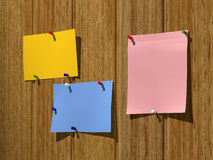 Leaflets on a wooden wall Royalty Free Stock Photography