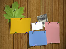 Leaflets on a wooden wall Royalty Free Stock Photo