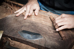 Leafroller crafting cigars Royalty Free Stock Photos