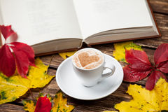 Leafs, book and cup Royalty Free Stock Images