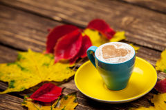 Leafs and coffee cup Stock Image
