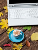 Leafs, notebook and coffee cup Royalty Free Stock Photos