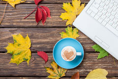 Leafs, notebook and coffee cup Stock Photos