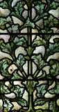 Leafs in stained glass Stock Photos