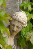 Leafy Lady. Romanesque statue in the grounds of Belton Hall, Lincolnshire Stock Photo