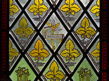 Leafy stained glass window. Details of yellow leaves on stained glass window royalty free stock photo