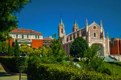Leafy trees and lawn on garden in front of Cathedral in Madrid. Leafy trees and lawn on garden in front of the Gothic San Jeronimo el Real Cathedral in Madrid stock photo