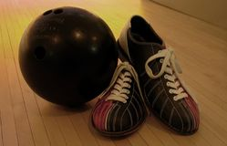 League Night. Bowling ball and bowling shoes Royalty Free Stock Photos