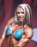 Curvy, Muscled Female Physique Athlete Poses at 2018 Toronto Pro Supershow Royalty Free Stock Image