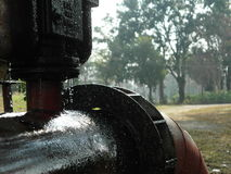 Leak. Ing water from the rust pipeline and wait repair plumber Royalty Free Stock Photography