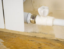 Leakage of the heating system in a private house. Royalty Free Stock Image