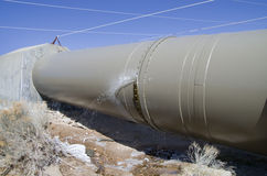 Leaking Aqueduct Pipe. Leaking Owens River water aqueduct pipe with ice under leak Royalty Free Stock Photo