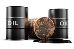 Leaking oil barrel. A leaking oil barrel spilling oil on the floor Royalty Free Stock Photography