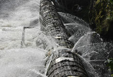 Leaking Pipe. A pipe that is leaking in all directions Royalty Free Stock Images