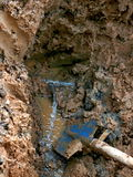 Leaking water pipes. Water comes out from cracked pipes Stock Photography